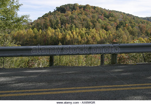 West Virginia Nicholas County Nettie trees fall colors rural road guard rail - Stock Image