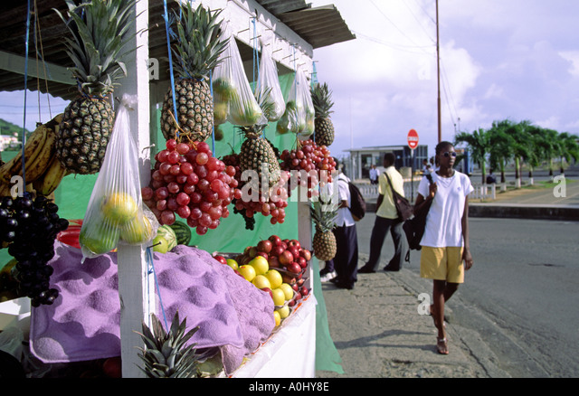 Tobago Scarborough market tropical fruits people - Stock Image