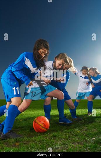 Young women playing football - Stock-Bilder