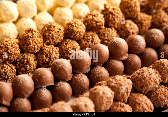 Rows of chocolates in a French cafe, France, Europe - Stock Image