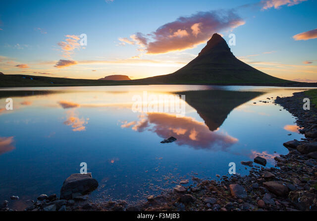 Sunset reflection of Kirkjufell mountain, Grundarfjordur, Snaefellsnes Peninsula, Vesturland, Iceland. - Stock Image