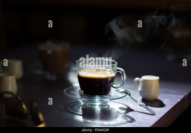 cup of hot coffee on the table - Stock Image