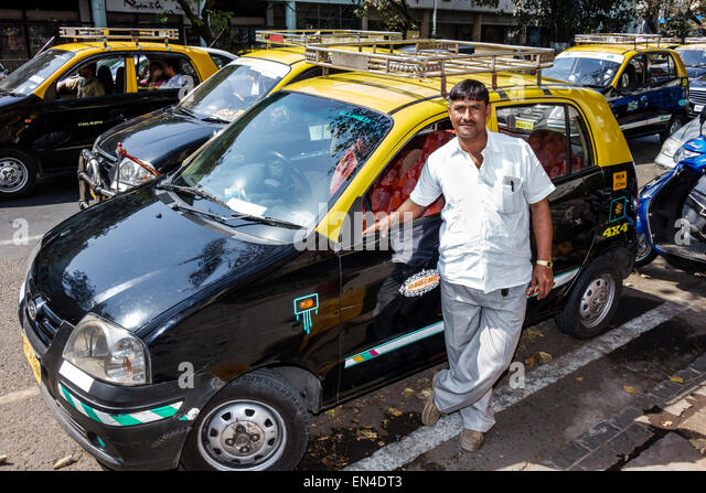 Mumbai India Asian Churchgate Veer Nariman Road taxi cab driver man - Stock Image