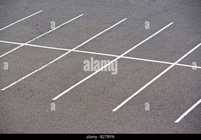 Rows of empty parking spaces - Stock Image