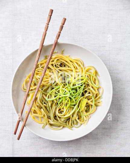 Asian noodles with leek on textile background - Stock Image