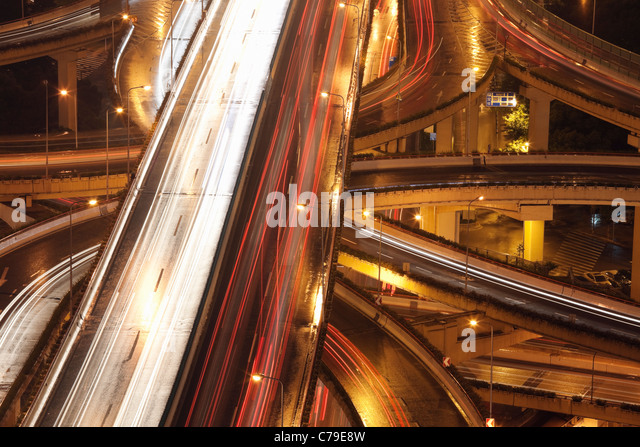 Car trails on Yan'an Rd East Interchange; Luwan; Shanghai; China - Stock-Bilder