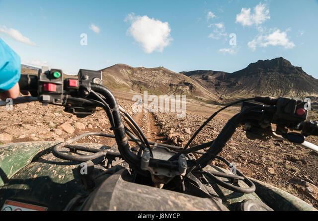 Quad bike on dirt road - Stock-Bilder