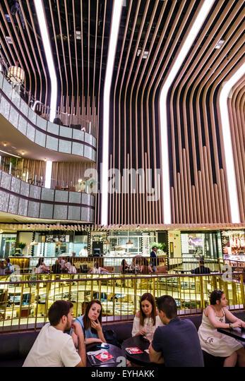 Madrid Spain Europe Spanish Recoletos Salamanca Calle de Goya Platea Madrid shopping Hispanic man woman couples - Stock Image