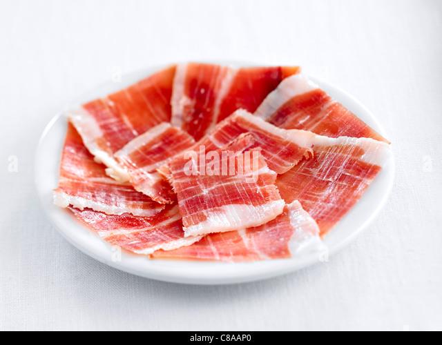 Sliced Serrano ham - Stock Image