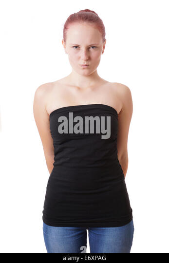 bashful young woman is pulling a face - Stock Image