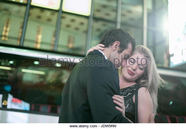 Tender young couple having night out, New York City, USA - Stock-Bilder