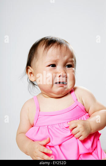 Portrait of baby girl, crying - Stock Image