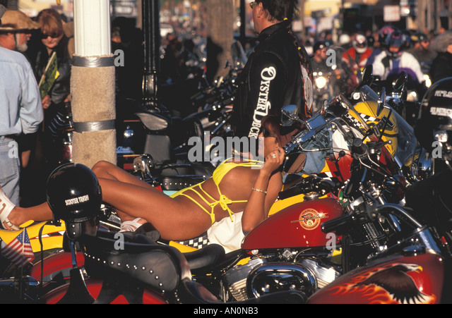 Daytona Beach Florida fl bike week woman lounging on motorcycle - Stock Image