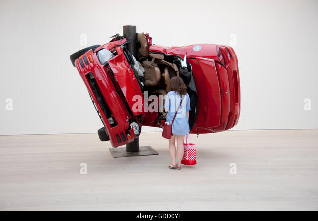 young woman looks at Dirk Skreber 'Car Crash 1' installation at the Saatchi Gallery London - Stock Image