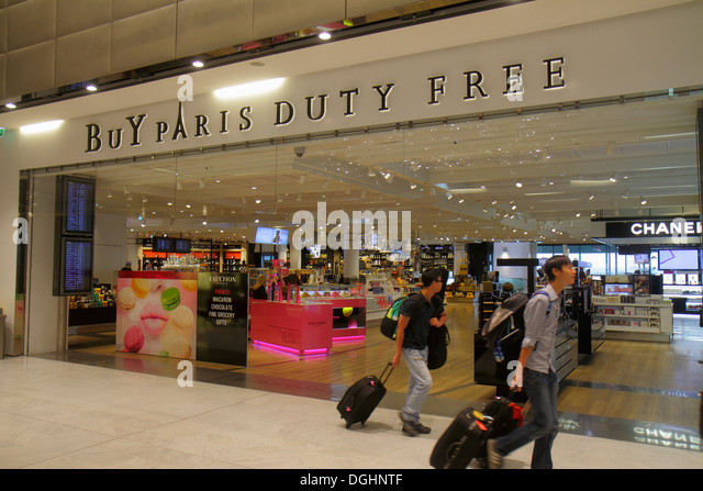 Paris France Europe French CDG Charles de Gaulle Airport terminal concourse gate area shopping Buy Paris Duty Free - Stock Image