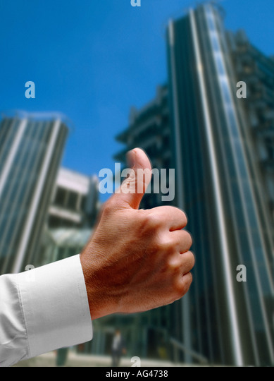 Thumbs up and high finance building for success and progress - Stock Image