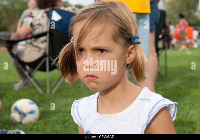 Closeup of six year old girl with a sad face - Stock Image