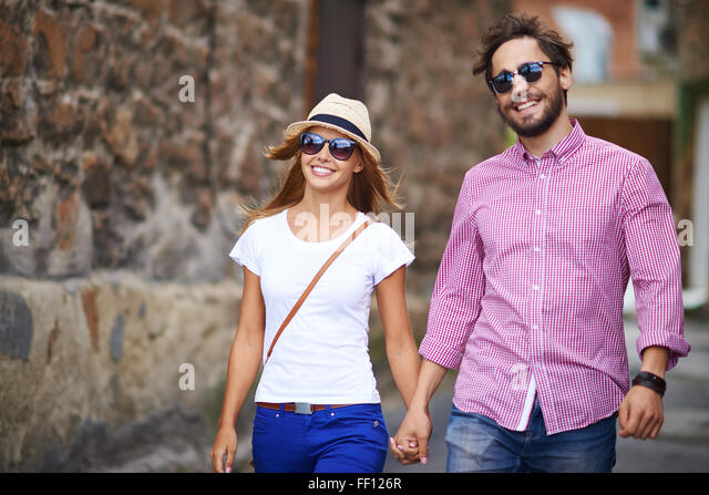 Couple of modern tourists sightseeing in foreign city - Stock Image