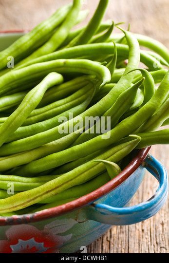 the fresh green beans in bowl - Stock Image