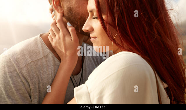 Close up shot of beautiful young woman with her boyfriend. Young couple together outdoors. - Stock-Bilder