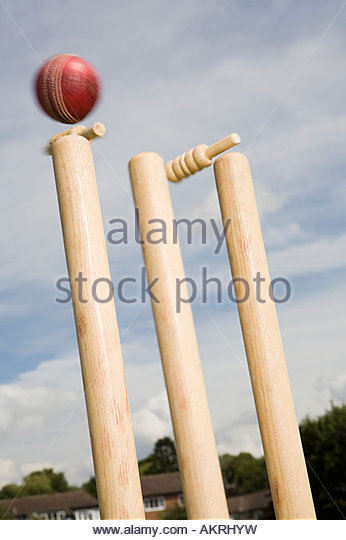 A cricket ball and stump - Stock Image