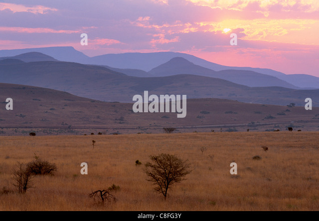 Sunset over escarpment near Blyde River Canyon, Mpumalanga, South Africa - Stock Image