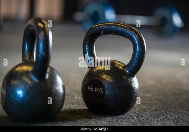 Kettlebells on gymnasium floor, close-up - Stock Image