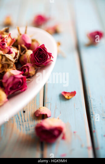 Beautiful dried roses on wooden background - Stock Image