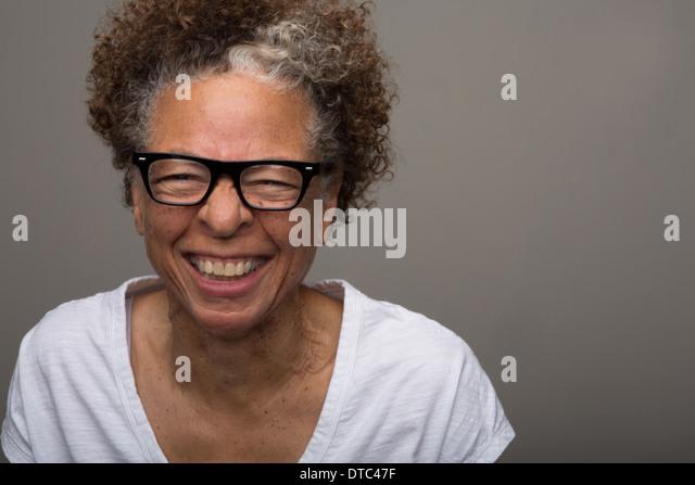 Studio portrait of happy senior woman - Stock Image