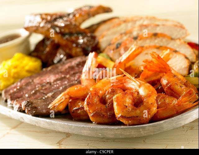 Shrimp, chicken, beef, shrimp and pork rib fajitas - Stock Image