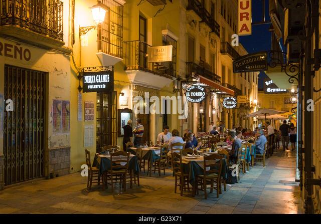 Restaurants outdoor,  twilight, Ronda, Andalusia, Spain - Stock Image