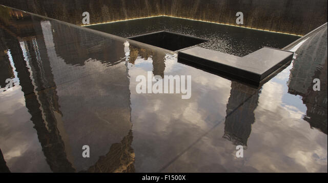 Reflection of highrises at 911 memorial, New York City - Stock Image