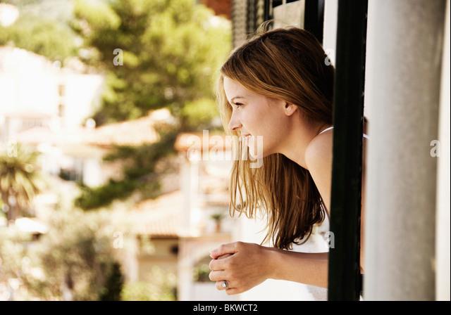 Girl in window - Stock Image