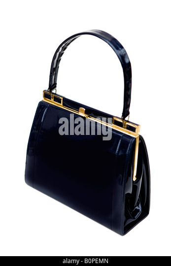 1950's/60's vintage black patent leather handbag - shot against a white background - Stock Image