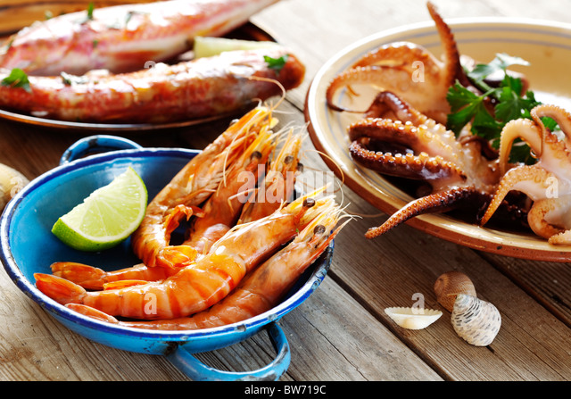 selection of seafood in a rustic setting - Stock Image