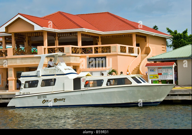 Belize City Tourism Village cruise ship tender brings passengers ashore western caribbean - Stock Image