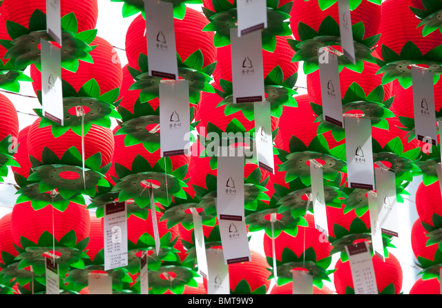 red and green prayer lanterns in a seoul south korean buddhist temple. - Stock Image