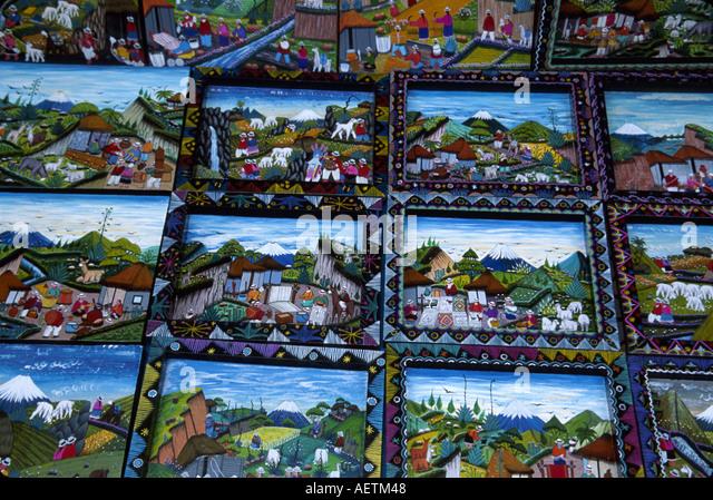 Ecuador Saquisili Market Otavalo Cotopaxi Chibuleos Indigenous natives primitive art paintings for sale - Stock Image