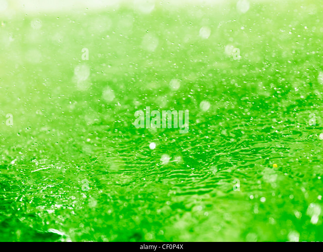 Lime green splashing water closeup abstract background texture - Stock Image