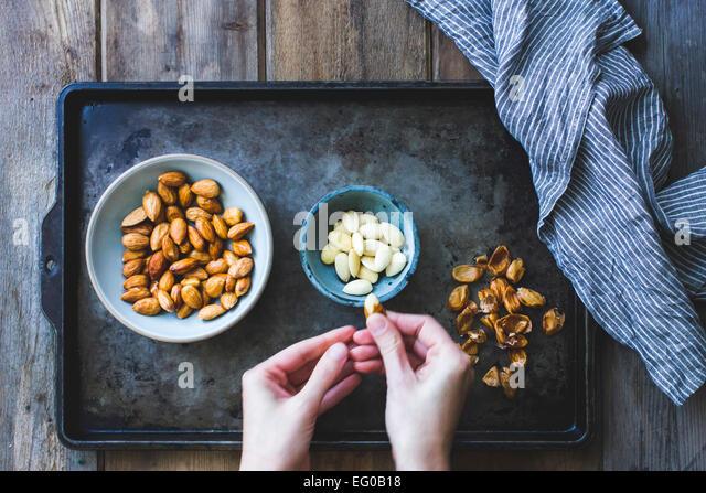 Blanching almonds - Stock Image