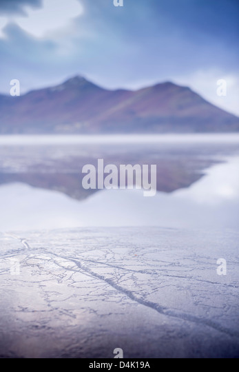 Layer of ice on rural lake - Stock Image