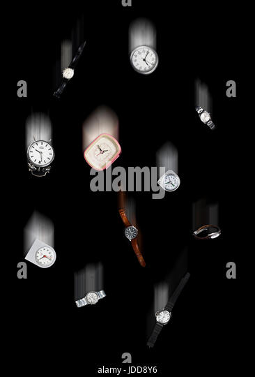 Watches and clocks fall to the ground - Stock Image