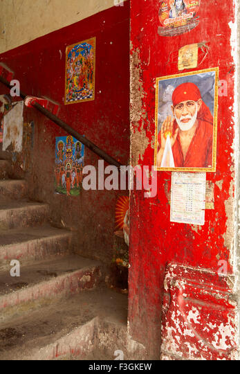 Images of Gods on the staircase of a commercial building discourages people to use as a spittoon ; Mumbai - Stock Image
