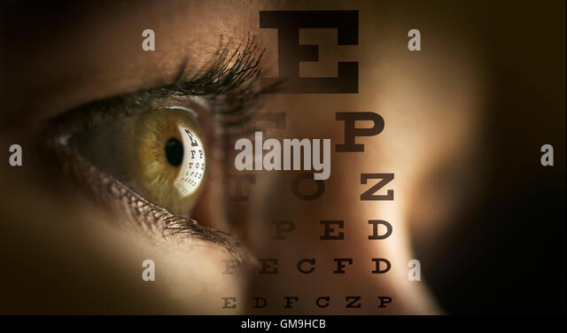Close-up of human eye and letters - Stock Image