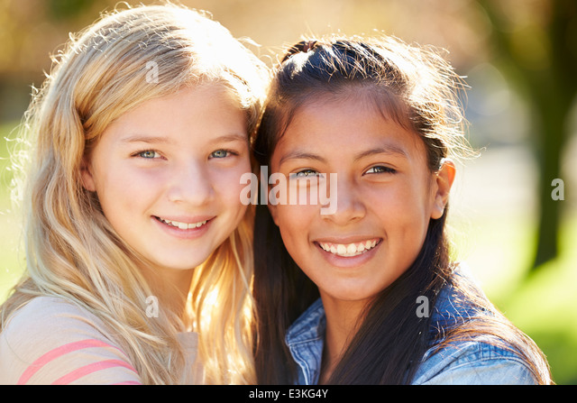 Portrait Of Two Pretty Girls In Countryside - Stock Image
