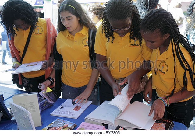 Miami Florida Miami-Dade College Wolfson Campus Miami Book Fair International exhibitors booths sellers buyers shopping - Stock Image