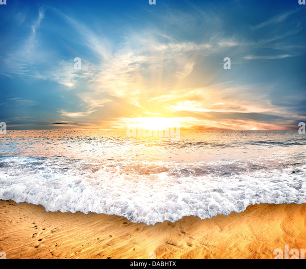 Tropical yellow sand beach and blue sky - Stock Image