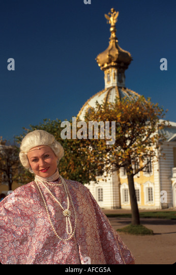 Russia former Soviet Union Peterhoff Petrodvorets Peter the Great Summer Palace woman dressed as Catherine - Stock Image