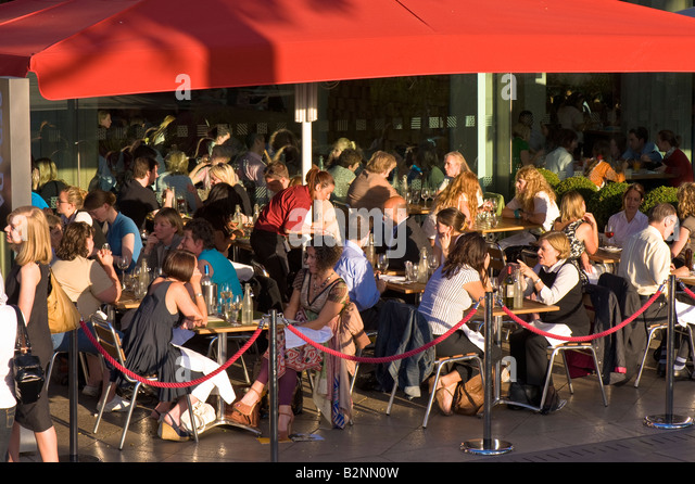 People enjoy food and drink by Royal Festival Hall Southbank SE1 London United Kingdom - Stock Image