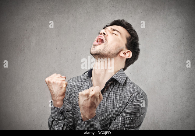 Young man rejoicing for his success - Stock Image
